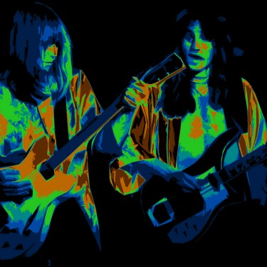ALEX LIFESON AND GEDDY LEE OF RUSH PERFORMING LIVE IN SPOKANE ON 9-16-77. PHOTO BY BEN UPHAM. MAGICAL MOMENT PHOTOS.