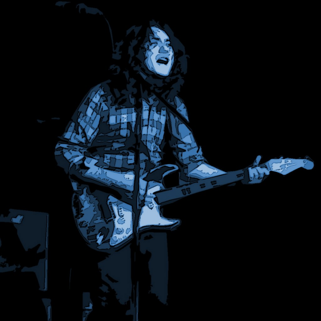 RORY GALLAGHER PERFORMING LIVE IN KENT, WA. ON 12-18-79. PHOTO ART BY BEN UPHAM. MAGICAL MOMENT PHOTOS.